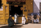 Egypt, men sitting near storefront