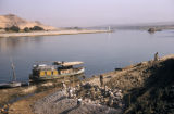 Egypt, men building a retaining wall on the shoreline of the Nile