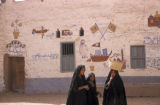 Egypt, people in front of a house that bears testimony to the owner's pilgrimage to the Muslim...