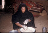 Egypt, woman making dough