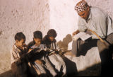 Upper Egypt region (Egypt), teacher and school boys reading