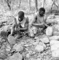 Orientale province (Democratic Republic of the Congo), men shaping laterite heads for building