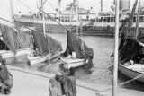 Egypt, fishing boats and steamship docked at harbor in Port Said