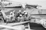 Egypt, men having lunch in boat on the Nile River