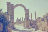 Libya, ruins of columns and archway at ancient city of Leptis Magna
