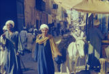 Egypt, crowded street market with people and donkey