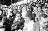 Morocco, audience in stands at royal view of troops in Fez