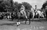 Morocco, Crown Prince Hassan on horseback in royal review of troops in Fez