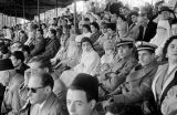 Morocco, audience in grandstand at royal review of troops in Fez