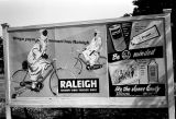 Nigeria, billboard advertising bicycles and insect spray
