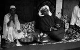 Morocco, men sitting around tea serving service