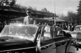 Morocco, King Muhammad V riding in car in military parade in Fez