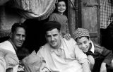 Morocco, group portrait of men and boys in Jewish Quarter of Marrakech