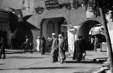Morocco, pedestrians passing through city gate in Rabat