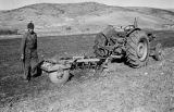 Morocco, farmer with tractor in field in Atlas Mountains