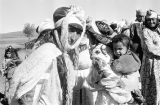 Morocco, Berber women carrying children on their backs