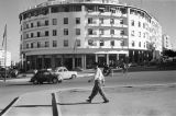 Morocco, man walking across from modern office building in Rabat