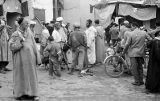 Morocco, men gathered in Jewish Quarter of Marrakech