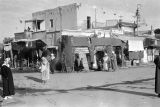 Morocco, building with market vendors in village
