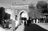 Morocco, people passing through Blue Gate in Fez