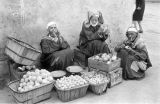 Morocco, men selling produce on street in souk