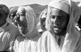 Morocco, Berber man singing with group in Atlas Mountains