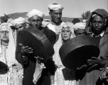 Morocco, Berber musicians playing instruments in Atlas Mountains