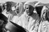 Morocco, Berber musicians singing and playing instruments in Atlas Mountains