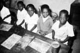 Nigeria, school children at elementary school classroom