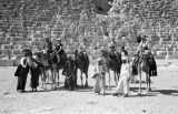 Egypt, Western tourists on camels in front of Giza pyramid
