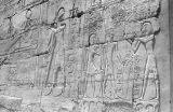 Egypt, hieroglyphics on ruins of stone wall in ancient city of Thebes