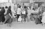 Egypt, women in Western clothing at vending cart in outdoor market