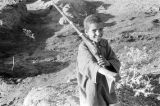 Morocco, portrait of boy with rifle at fantasia performance