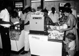 Nigeria, customers making purchases at modern supermarket in Lagos