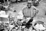 Nigeria, vendor selling fetishes at outdoor market in Lagos