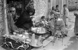 Morocco, merchant pouring tea in Marrakech