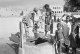 Mali, women and children at village well