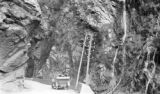 Algeria, car on bridge in Tell Atlas mountains