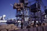 Africa, workers loading ship at docks
