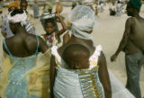 Senegal, woman carrying child on back