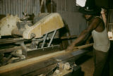 Africa, man working in lumber mill
