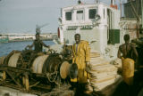 Senegal, men on boat in harbor