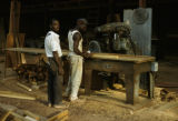 Burkina Faso, men woodworking with machinery