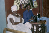 Senegal, man and woman with sewing machine