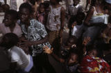 Senegal, crowd of people outside