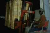 Dakar, dock worker transporting goods with forklift