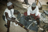 Burkina Faso, man making sandals from old rubber tires
