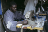 Senegal, tailor at sewing machine