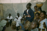 Senegal, man telling story with drum accompanyment
