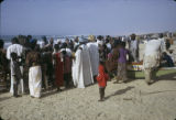 Senegal, people on beach with painted fishing boats